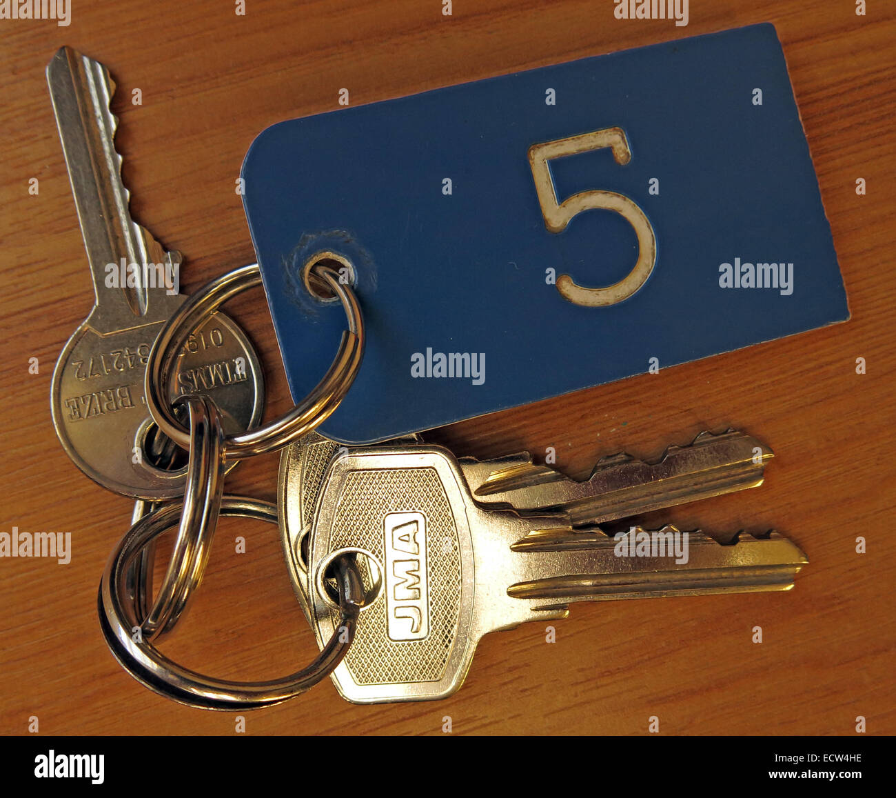 Bunch of keys for Room number 5 Stock Photo