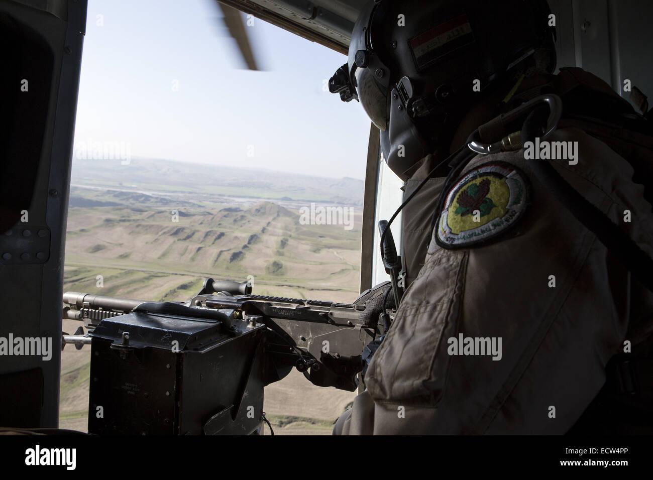 Dec. 11, 2014 - Fishkhabour, Iraqi-Kurdistan, Iraq - 11/12/2014. Fishkhabour, Iraq. The door gunner of an Iraqi - Stock Image