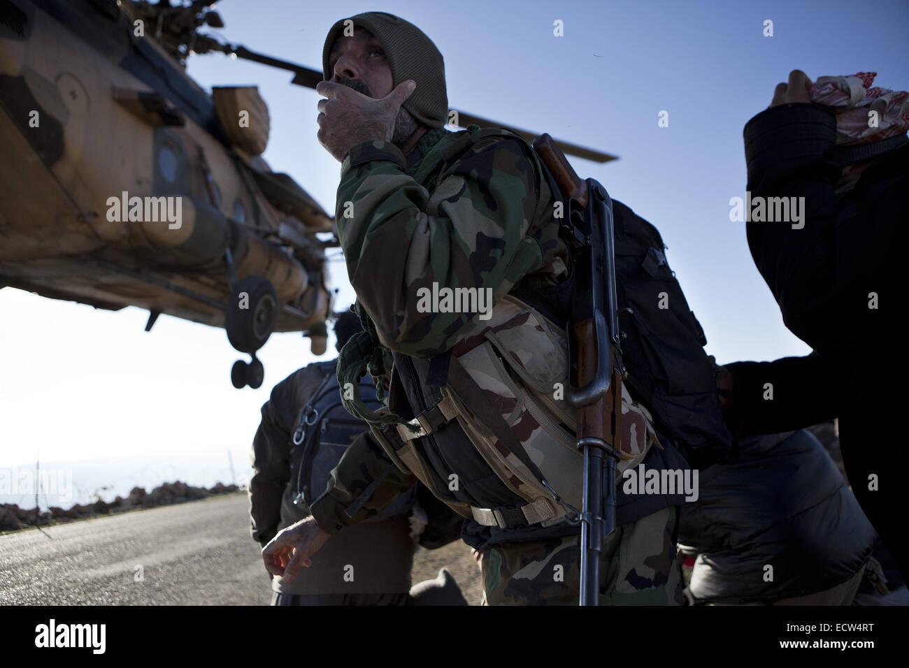 Dec. 11, 2014 - Sinjar Mountains, Iraqi-Kurdistan, Iraq - 11/12/2014. Sinjar Mountains, Iraq. A Yazidi fighter holds - Stock Image
