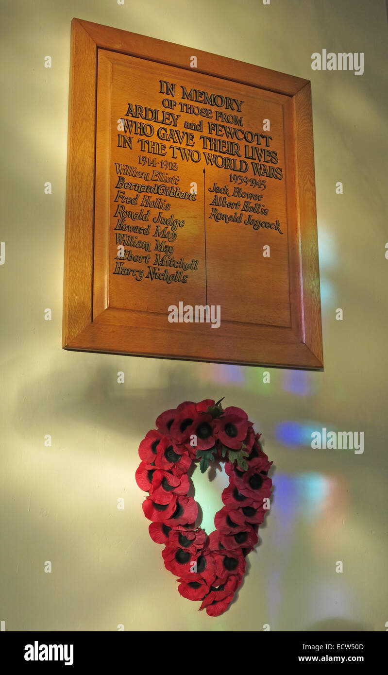 In memory of the Fallen plaque, St Marys Ardley, Oxfordshire, England, United Kingdom. With remembrance poppies Stock Photo