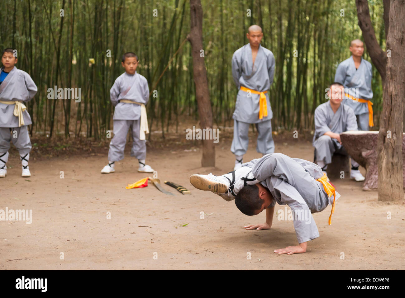Young student of a Shaolin martial arts school showing his flexibility at the opening ceremony of Zhengzhou International - Stock Image