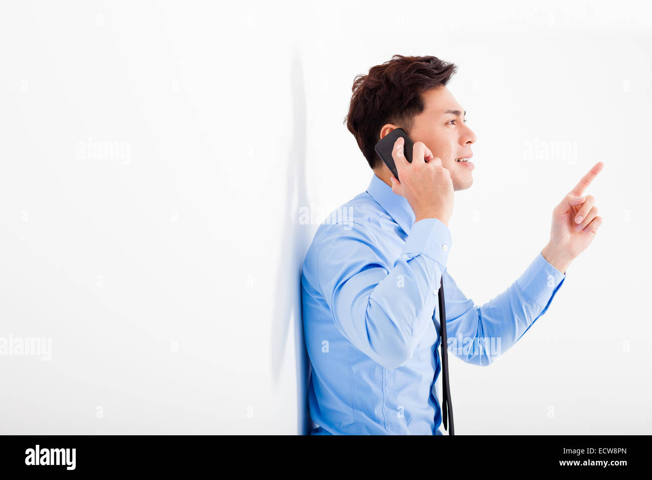 businessman talking on the phone in office - Stock Image