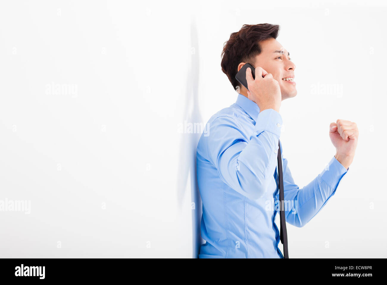successful businessman talking on the phone in office - Stock Image