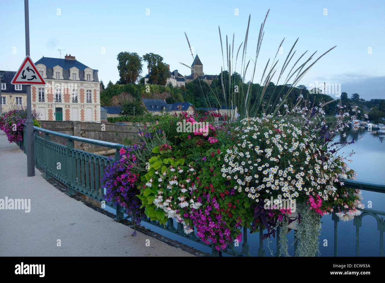 Amenity bedding display in planters on a bridge over the Mayenne in Chateau Gontier, France Stock Photo