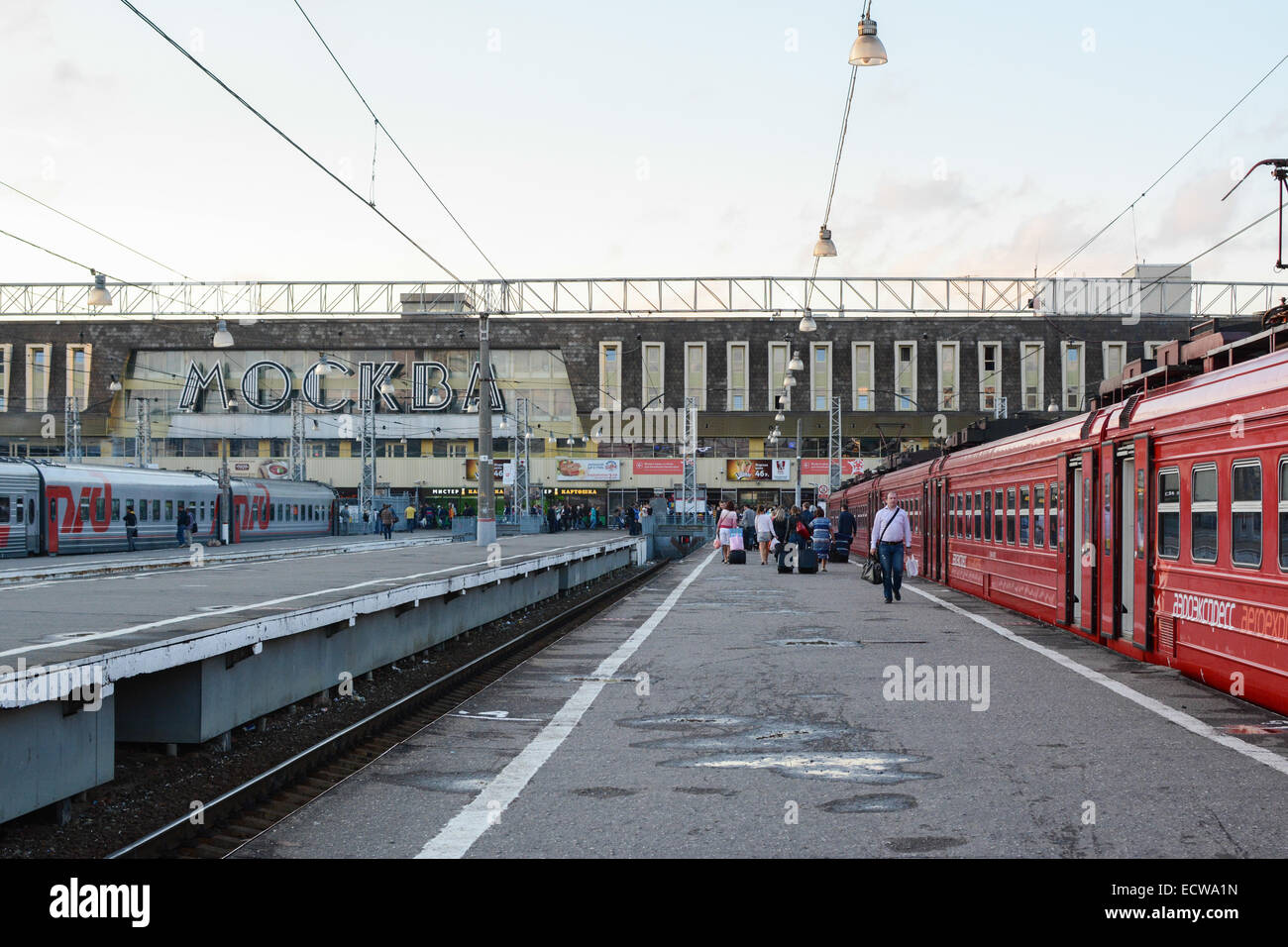 Passengers and trains at the platform of Paveletsky Railway Station, Moscow, Russia - Stock Image