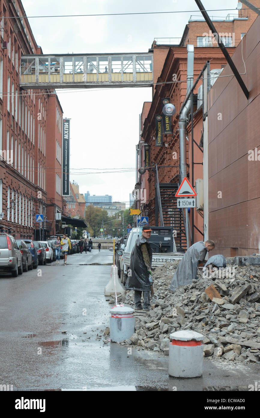 Workmen working on roadworks next to Red October Chocolate Factory arts centre - Stock Image