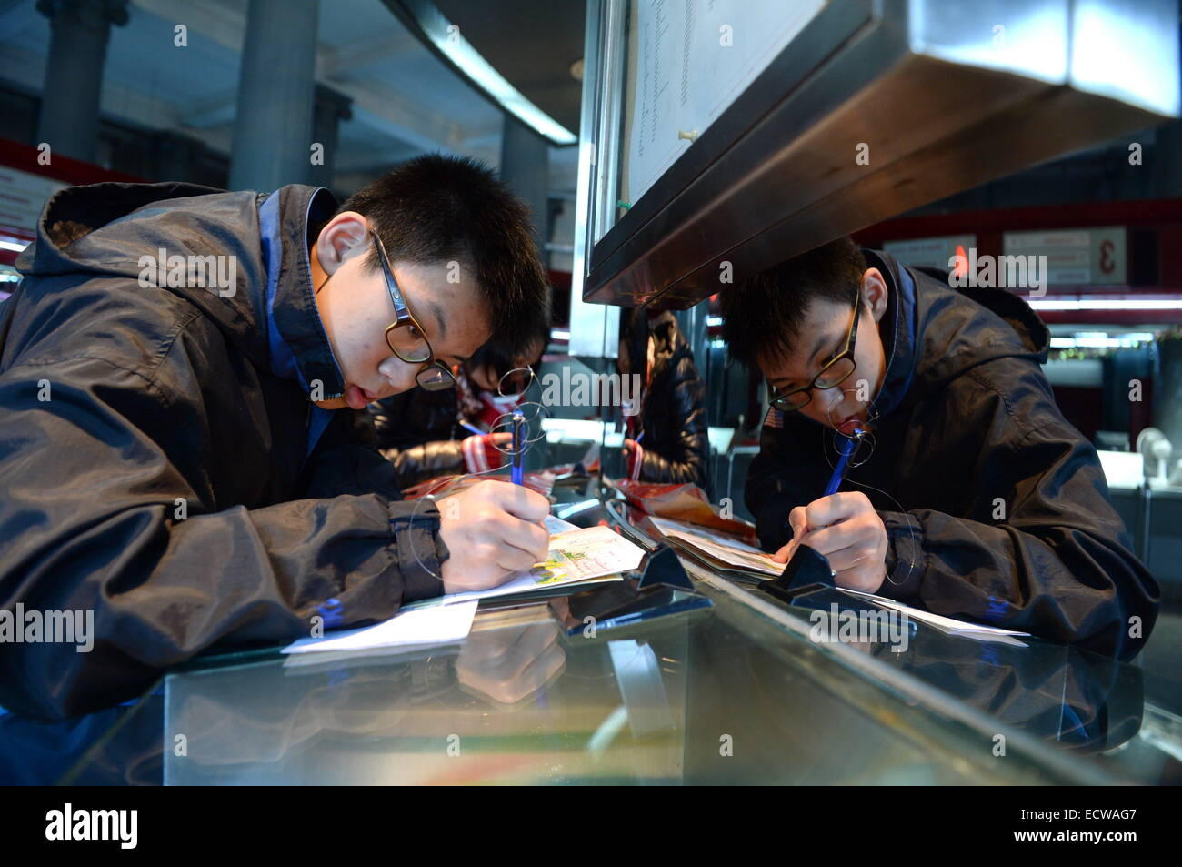 Macao, China. 20th Dec, 2014. A junior high school student mails to his family at a post office in Macao, south - Stock Image