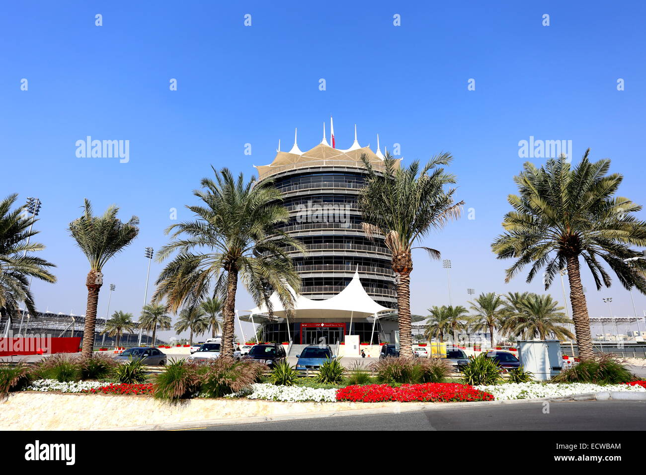 VIP tower with palm trees in front at the Formula 1 circuit, Sakhir, Kingdom of Bahrain - Stock Image