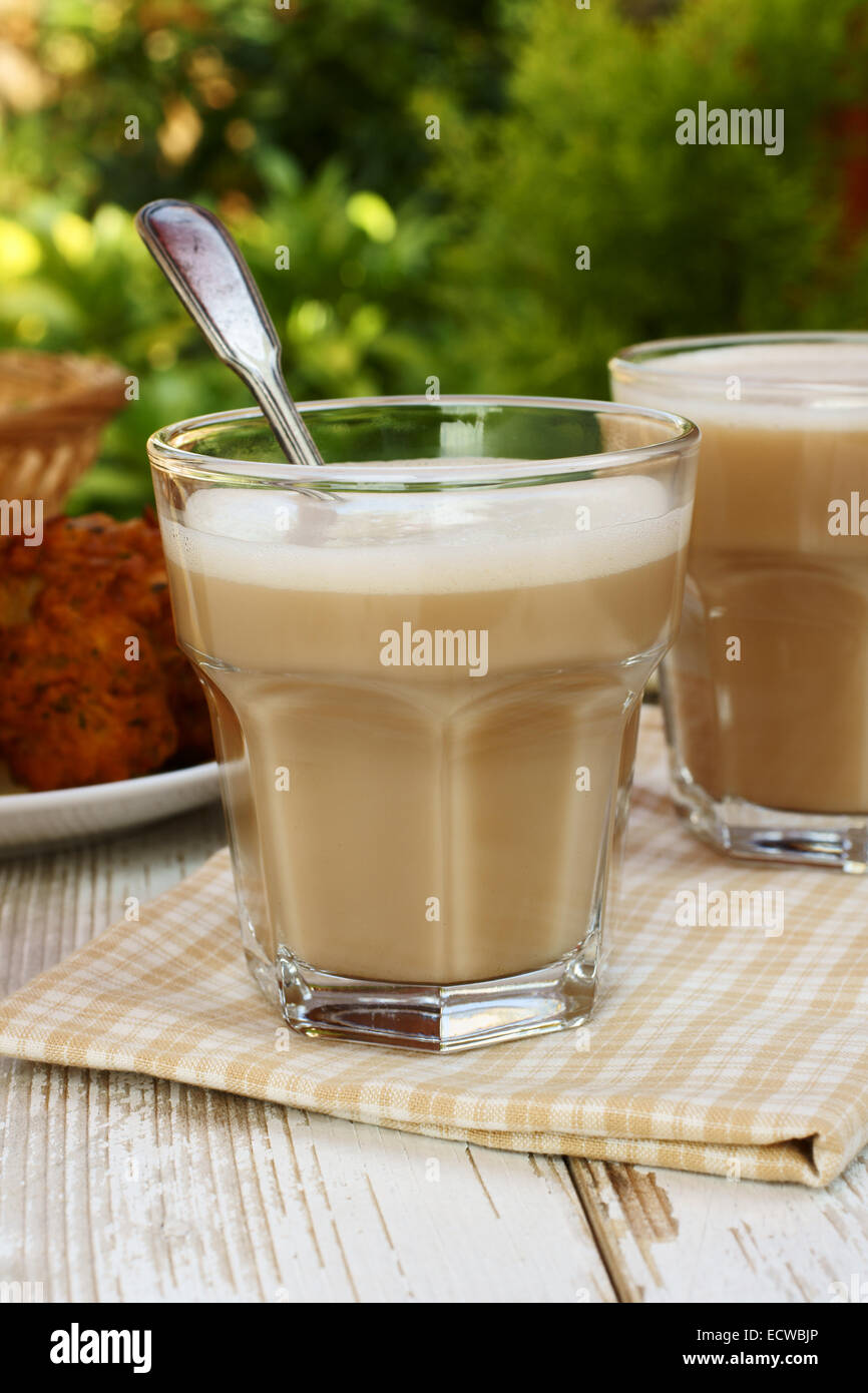 Chai or black tea made with milk and various spices Stock Photo