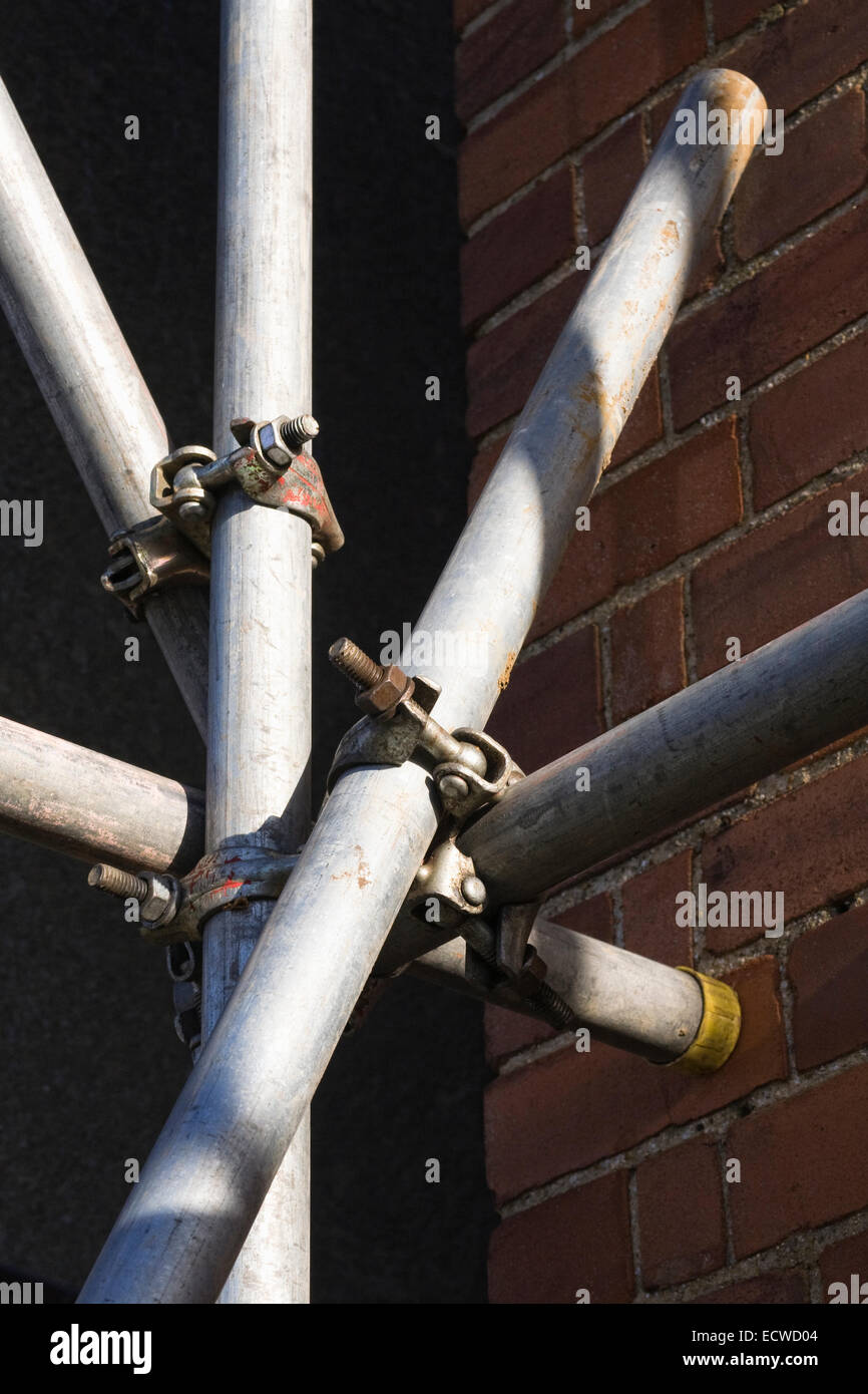 Abstract scaffolding pattern against a house wall. - Stock Image