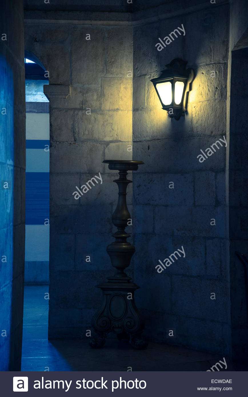 Wall lantern and huge candlestick - Stock Image