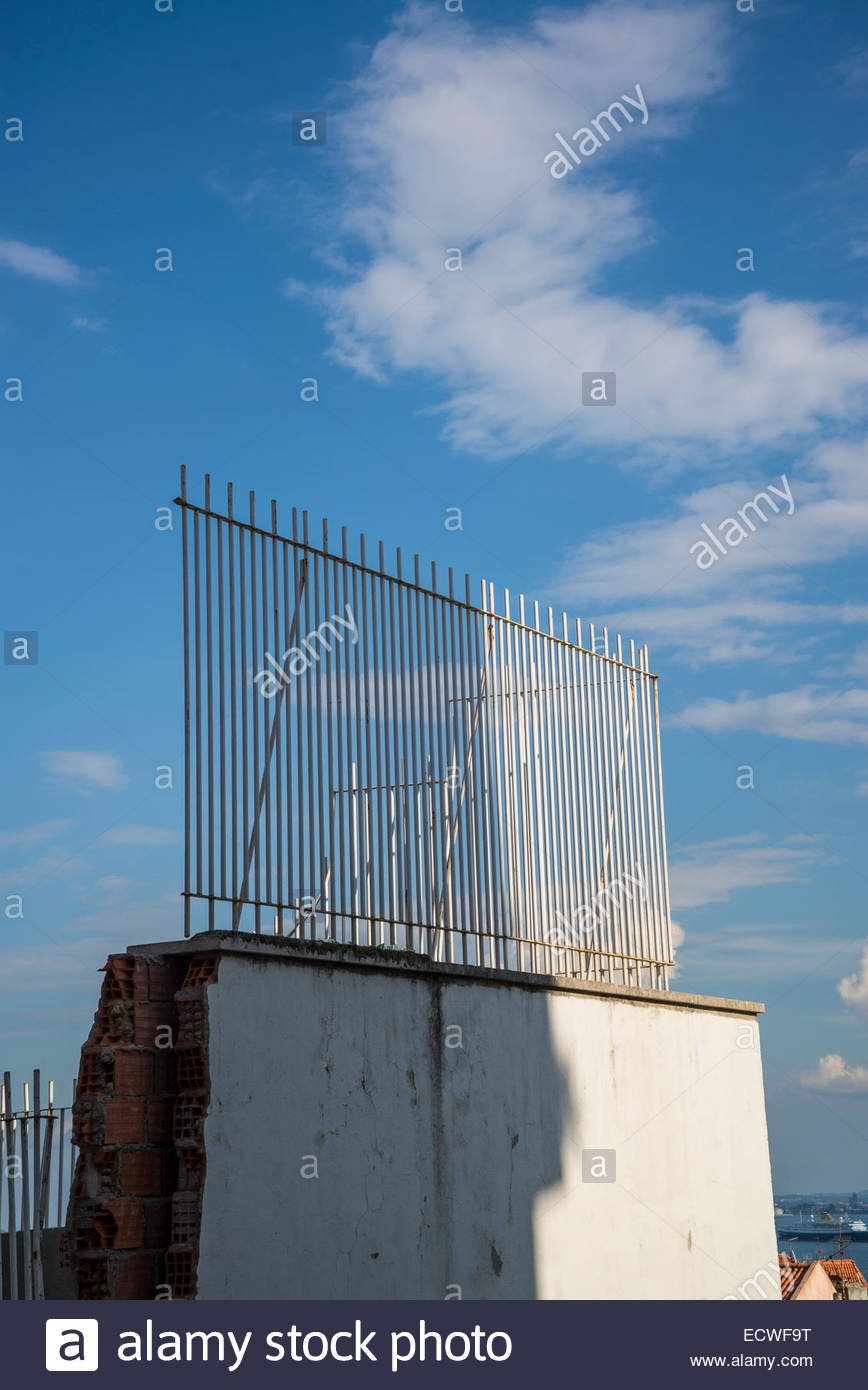 White fence on broken wall - Stock Image