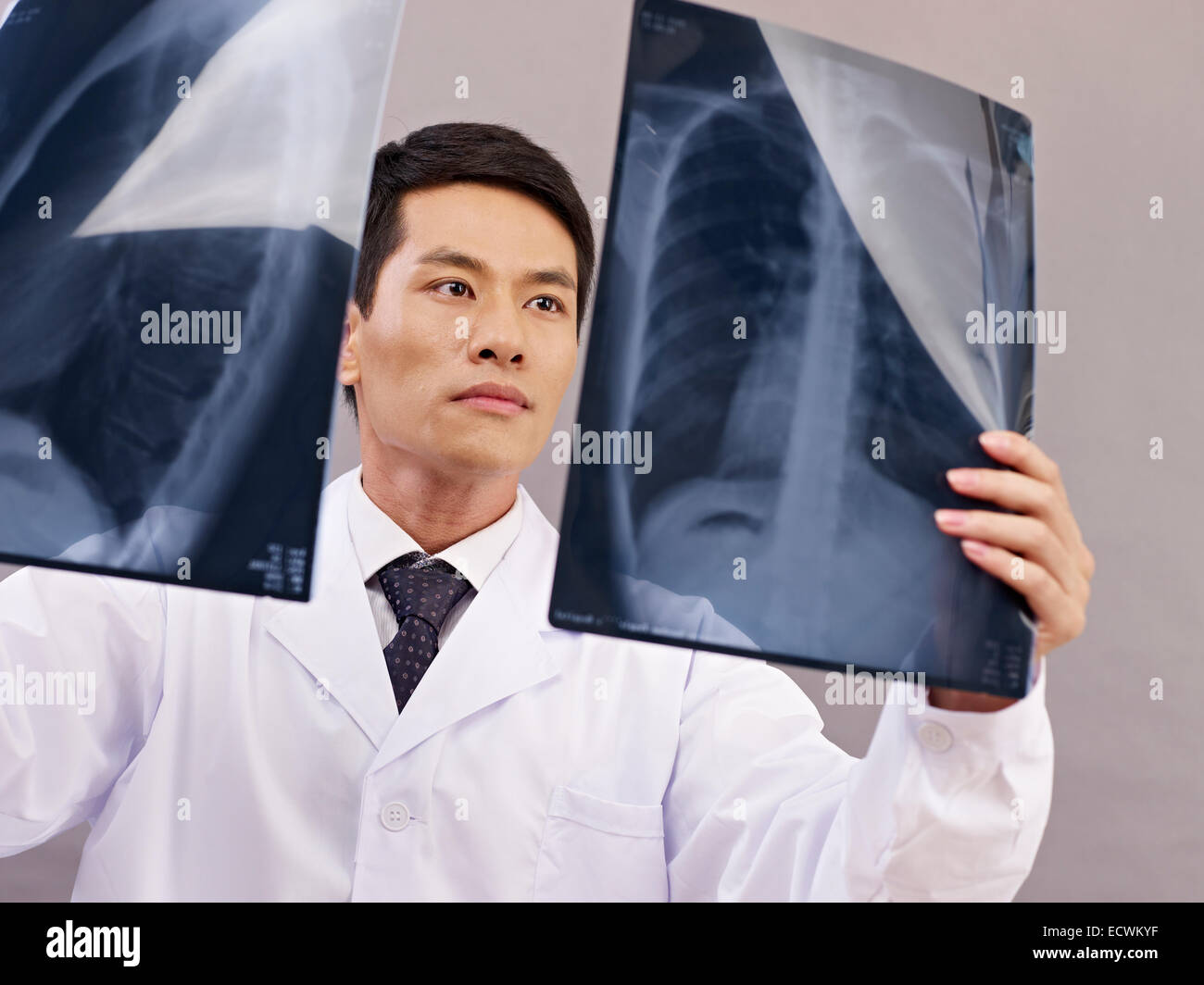 asian doctor at work - Stock Image