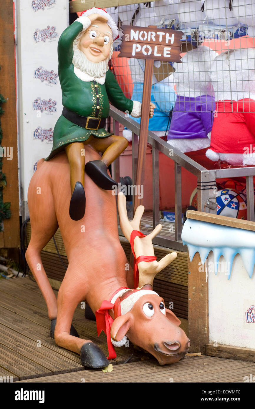 Elf and Very tired reindeer with a sign to the north pole Stock Photo