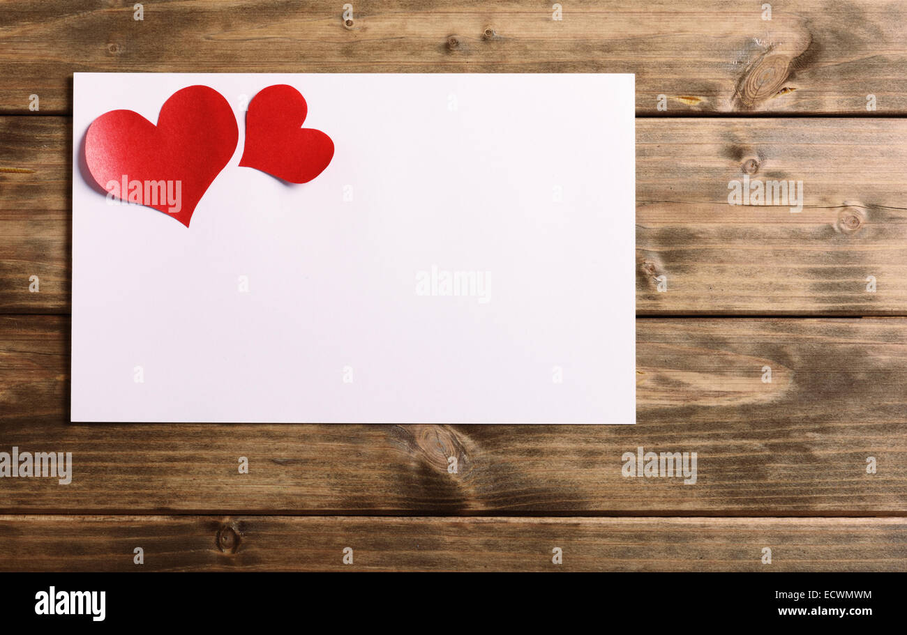 greeting card with a red heart and space for text on a wooden background - Stock Image