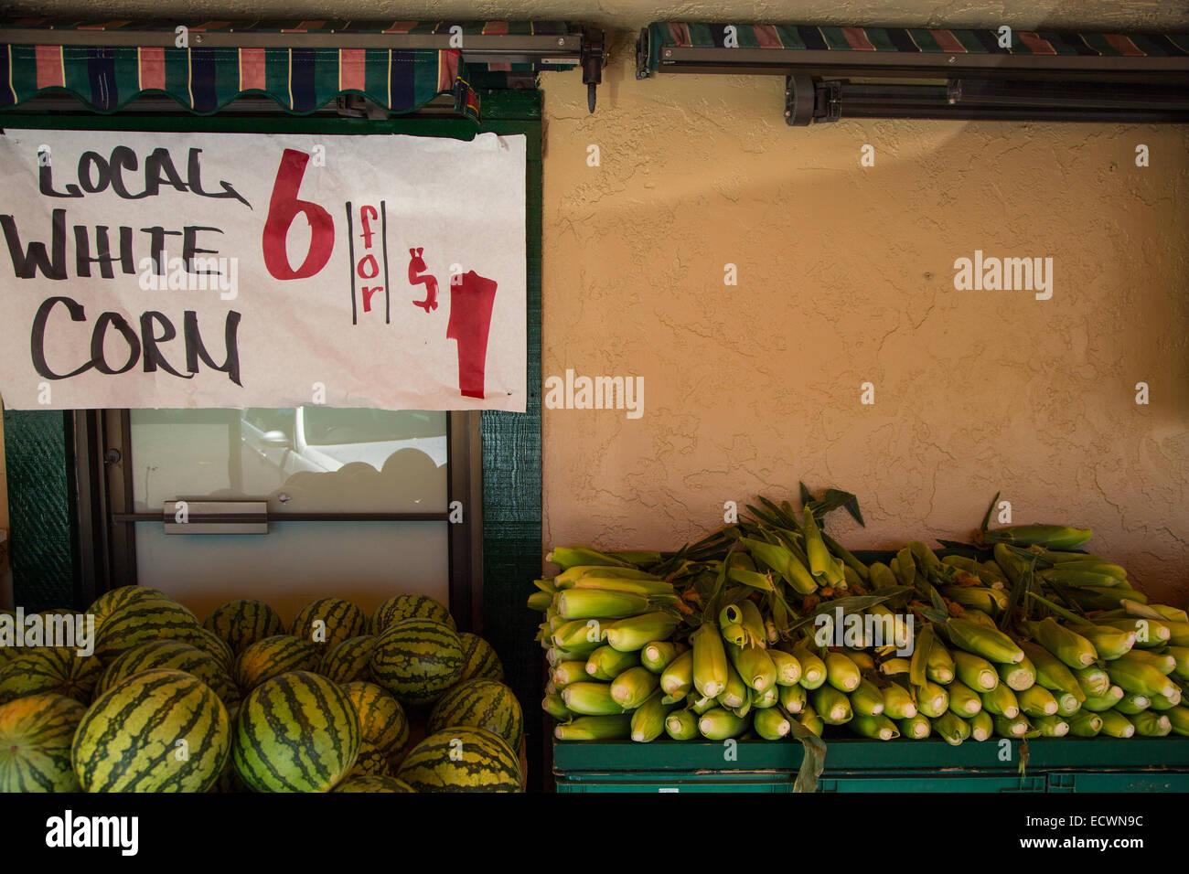 Local corn and watermelons for sale at local produce market - Stock Image