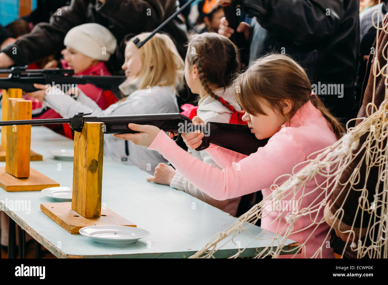 Unrecognizable Belarusian secondary school pupils girl shooting an air rifle at a school sports competition 'Ski - Stock Image