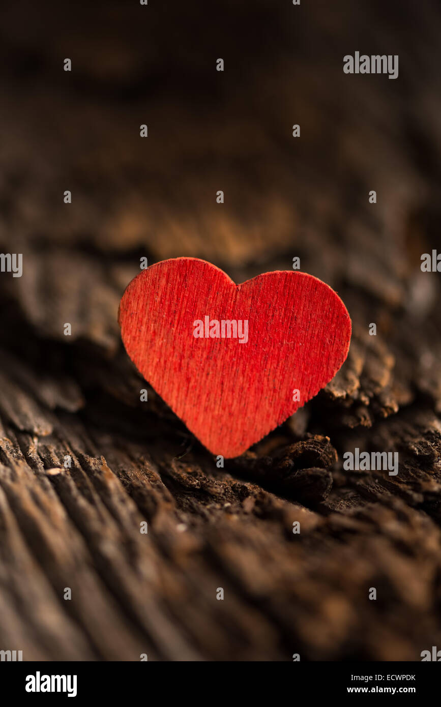 Wood red heart set on rustic wood with selective focus - Stock Image