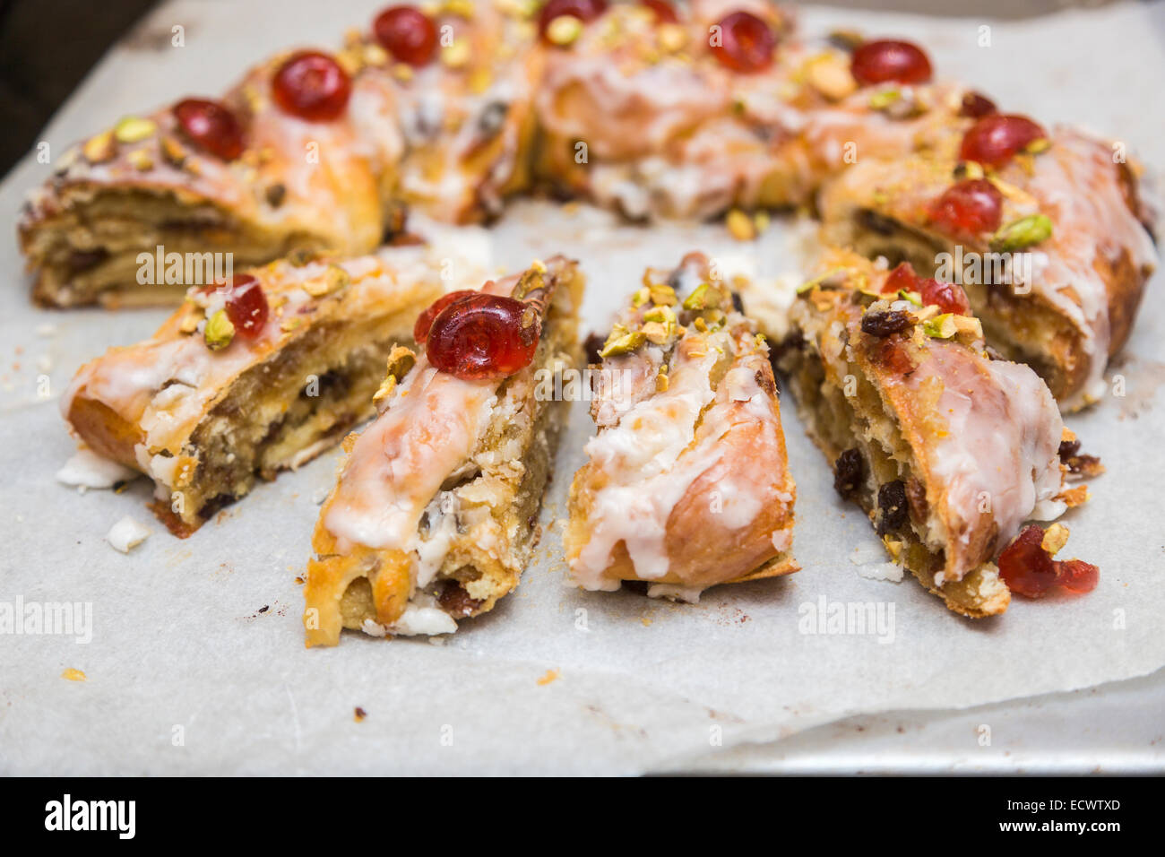 Mincemeat and marzipan couronne with glacé cherries decoration as featured in the Great British Bake Off Christmas - Stock Image
