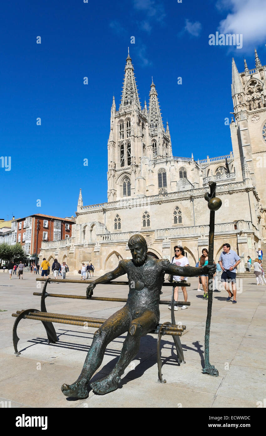 BURGOS, SPAIN - AUGUST 13, 2014: Statue of Pilgrim on the Camino de Santiago in front of the gothic cathedral in Stock Photo