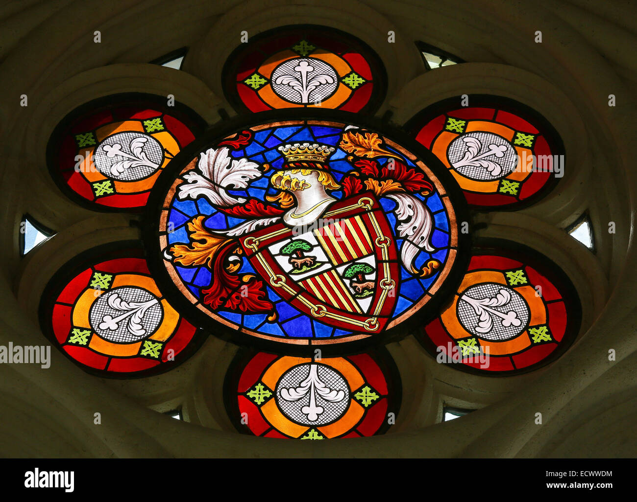 Stained glass window depicting a Coat of Arms in the cathedral of Burgos, Castille, Spain. - Stock Image