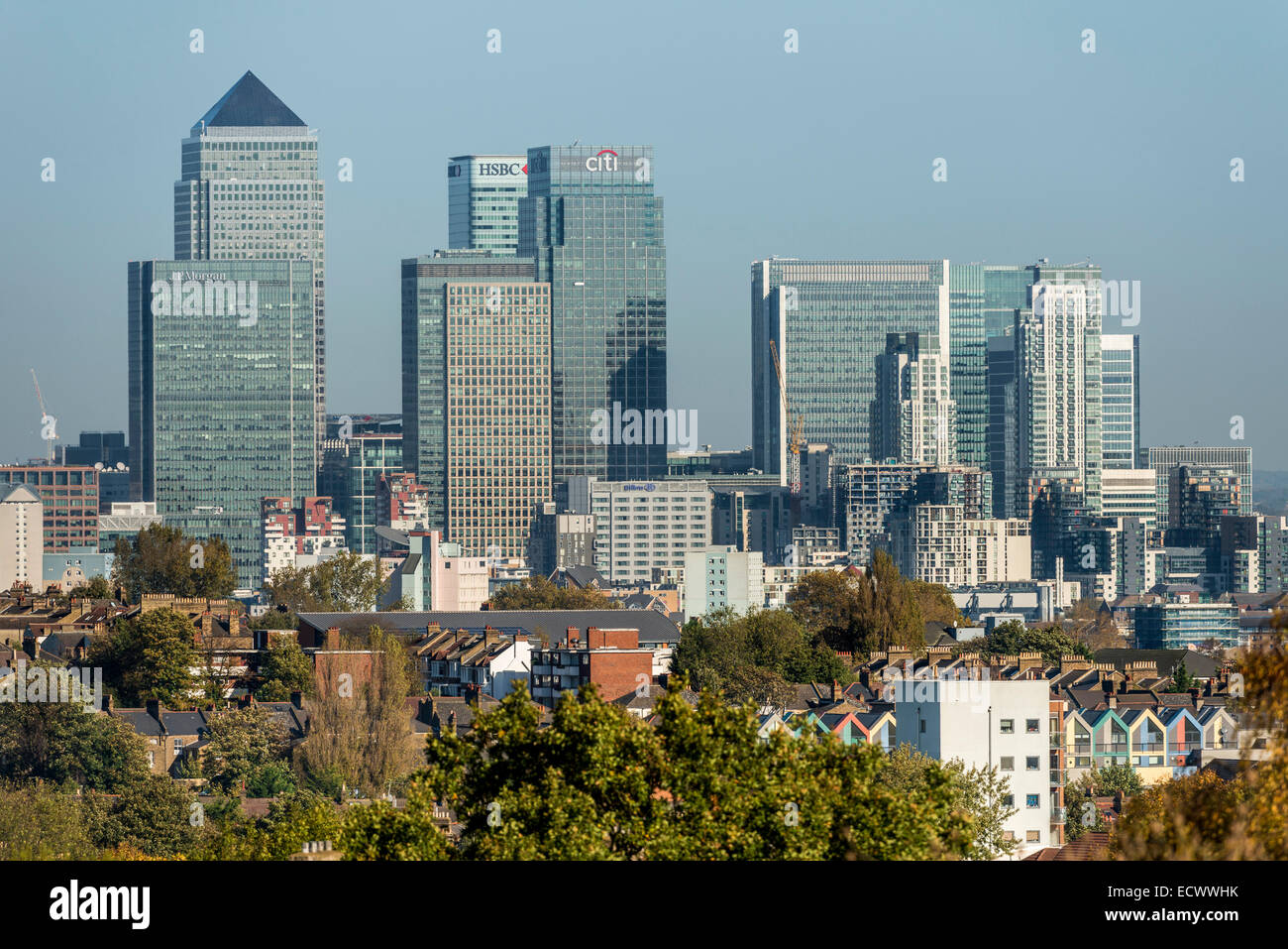 Views of Canary Wharf, the second financial district of London viewed across the rooftops of South London - Stock Image