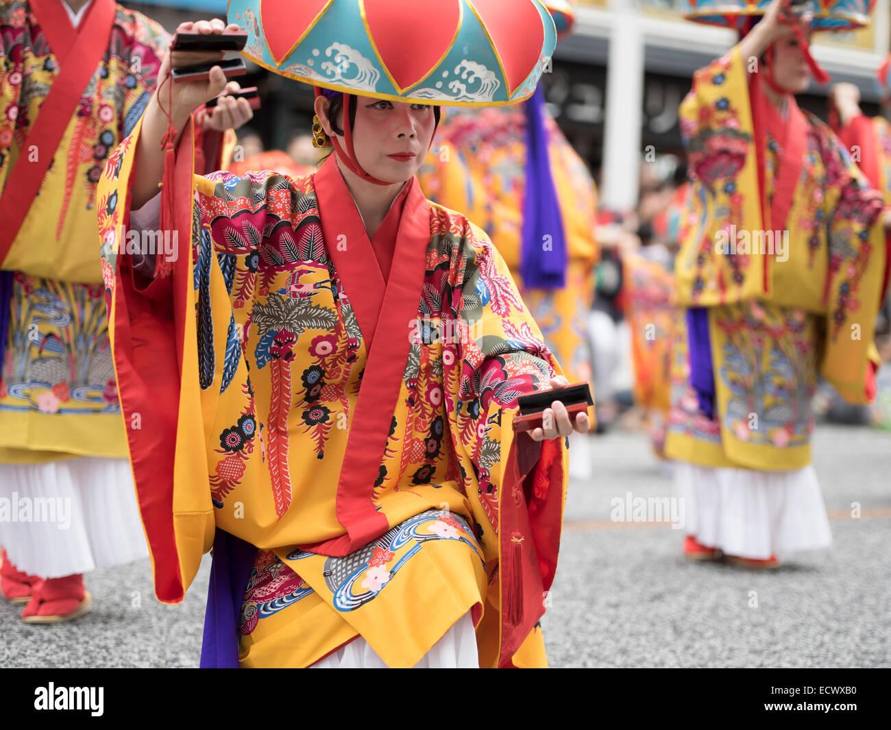 Parade of traditional ryukyu dancers wearing bingata kimonos and hanagasa hats. Kokusai-dori aka International Street, - Stock Image
