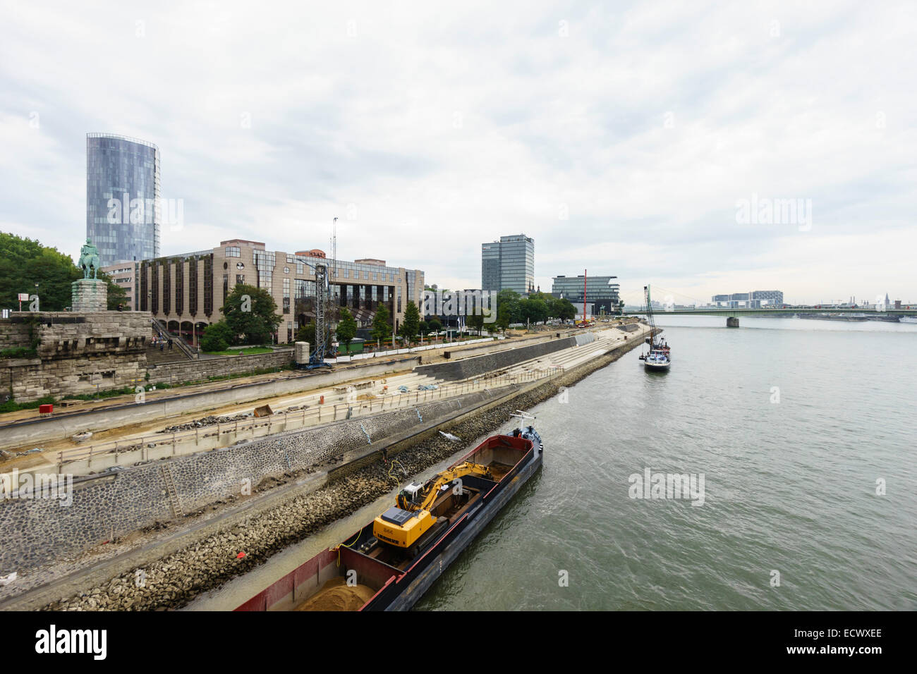Construction work strengthening the banks of the Rhine river in Cologne, Germany Stock Photo