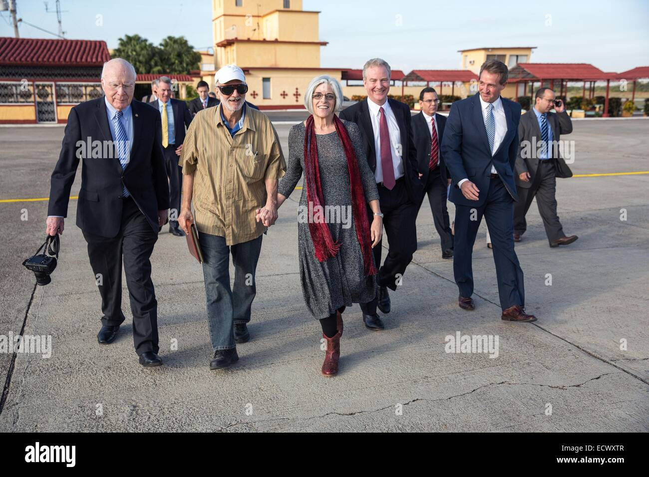 USAID contractor Alan Gross, imprisoned in Cuba for five years, walks to an awaiting aircraft with his wife Judy Stock Photo