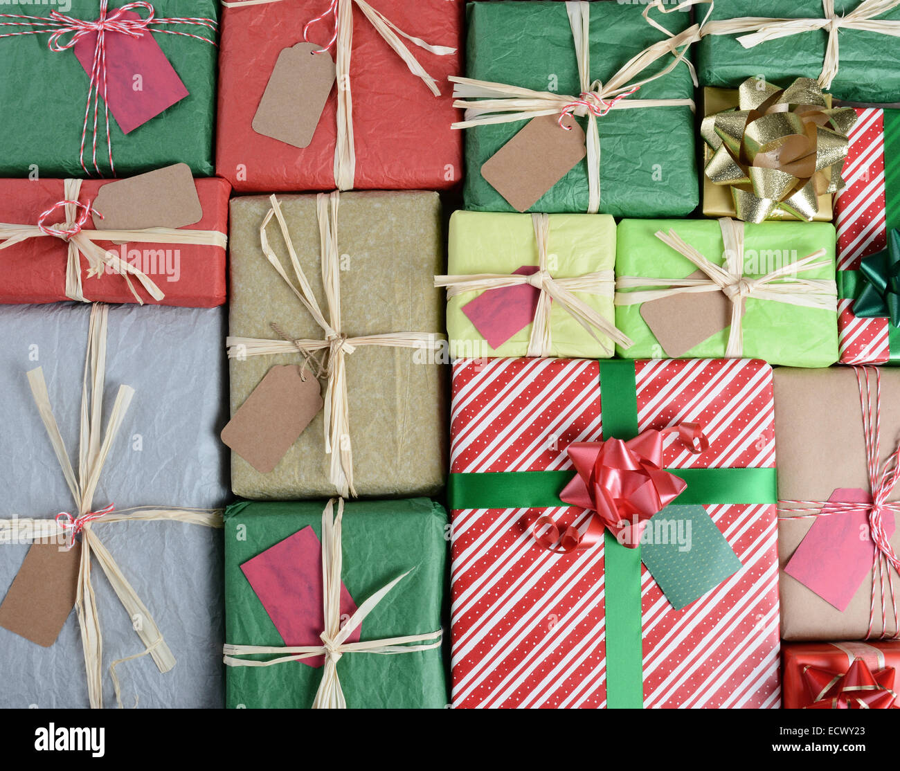 High angle shot of a large group of Christmas Presents. Wrapped in various papers and styles the the image fills - Stock Image