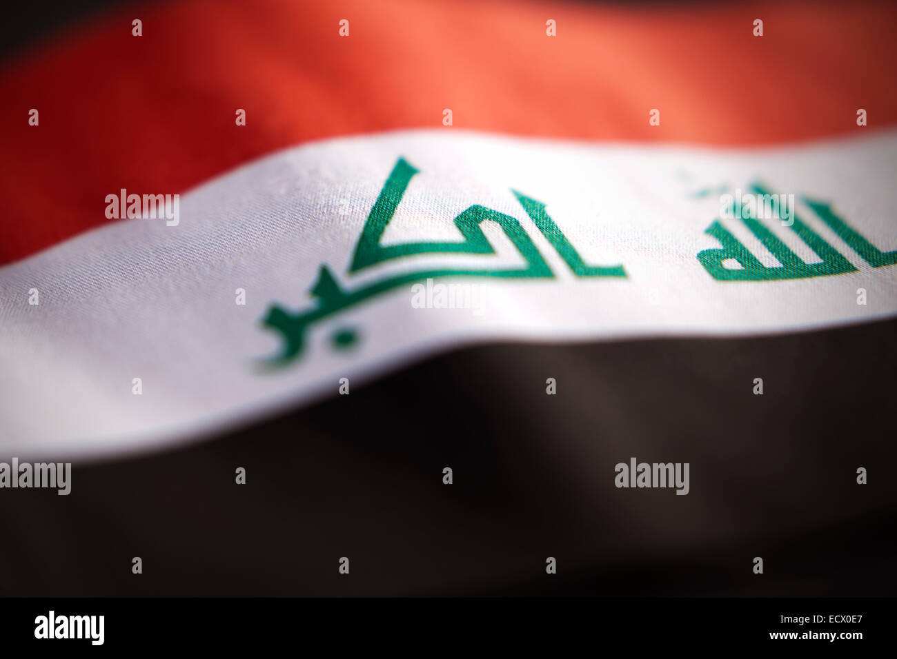 Abstract macro view of Iraq flag with shallow depth of field. - Stock Image