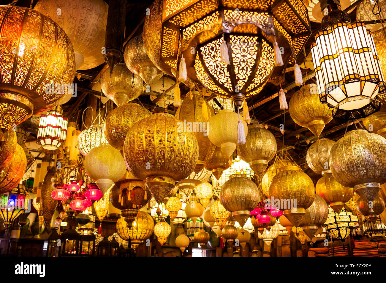 Low angle view of various illuminated lamps in market - Stock Image