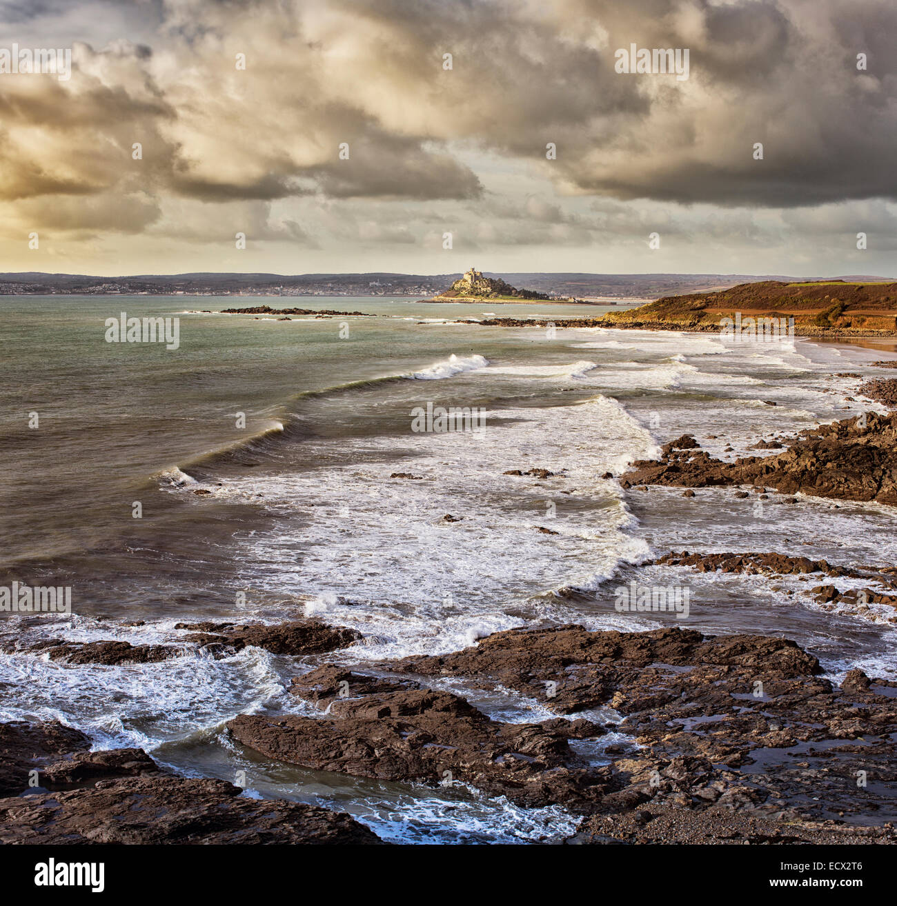 Scenic view of seaside landscape with waves crashing on rocky beach - Stock Image