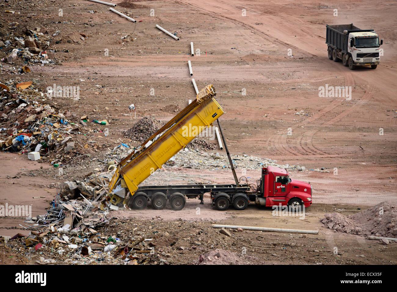 Dump Truck Unloading In A Landfill