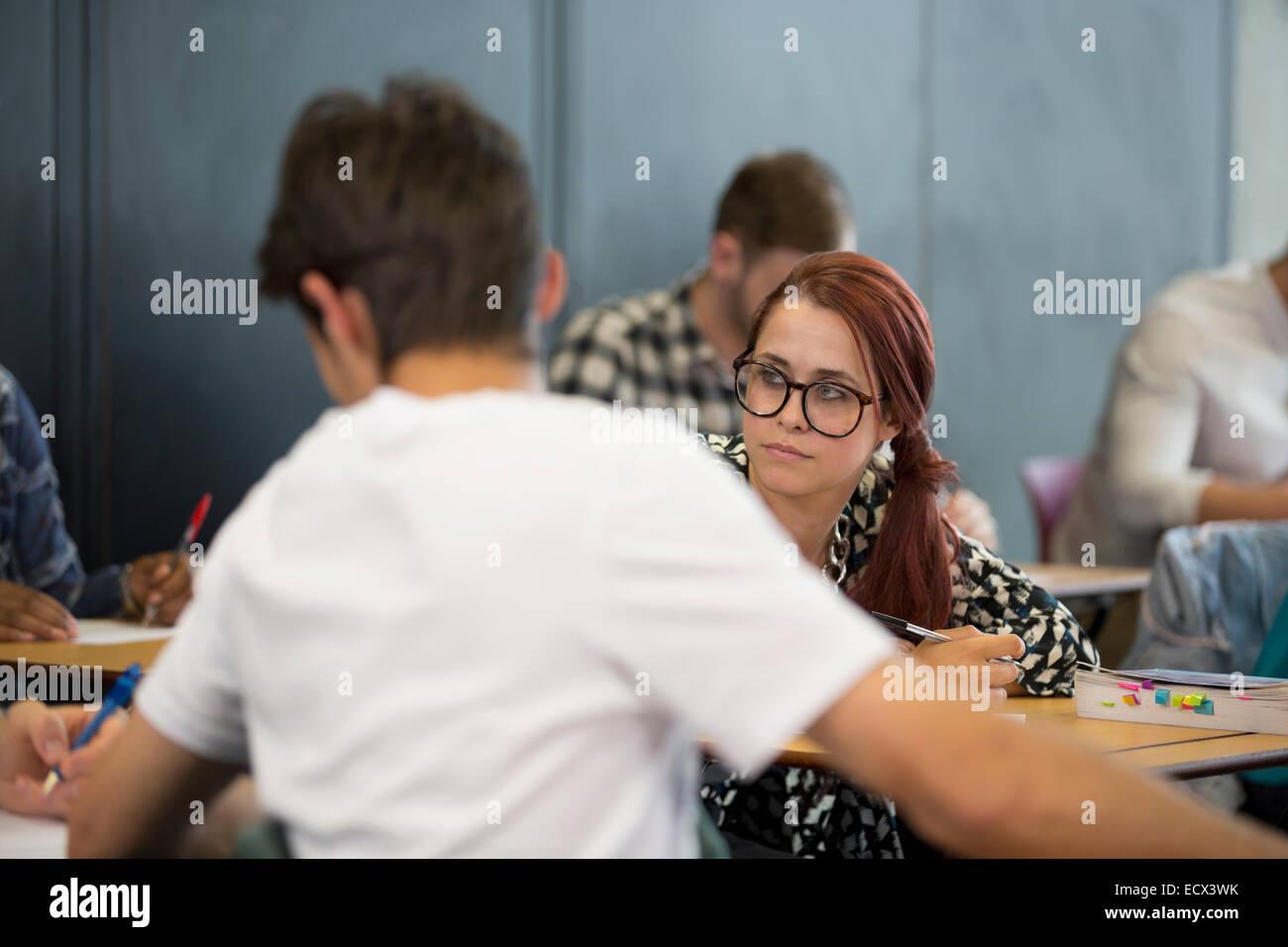 University students taking notes during seminar - Stock Image