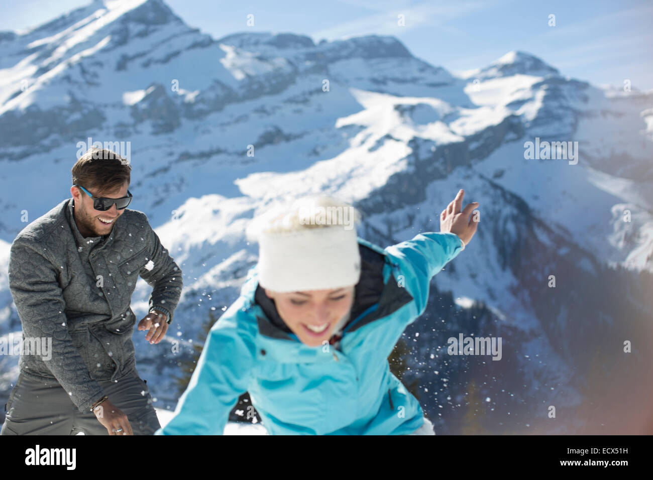 Couple playing in snow - Stock Image