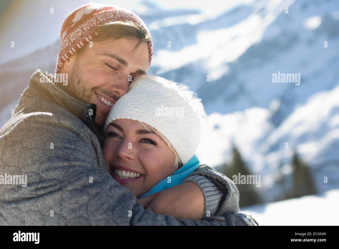 Couple hugging in snow - Stock Image