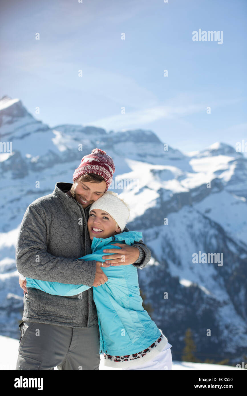 Couple hugging at mountains - Stock Image