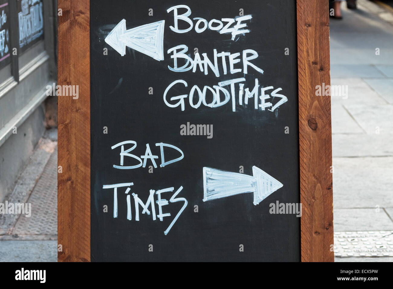 Chalk board in front of a pub with good times versus bad times - Stock Image