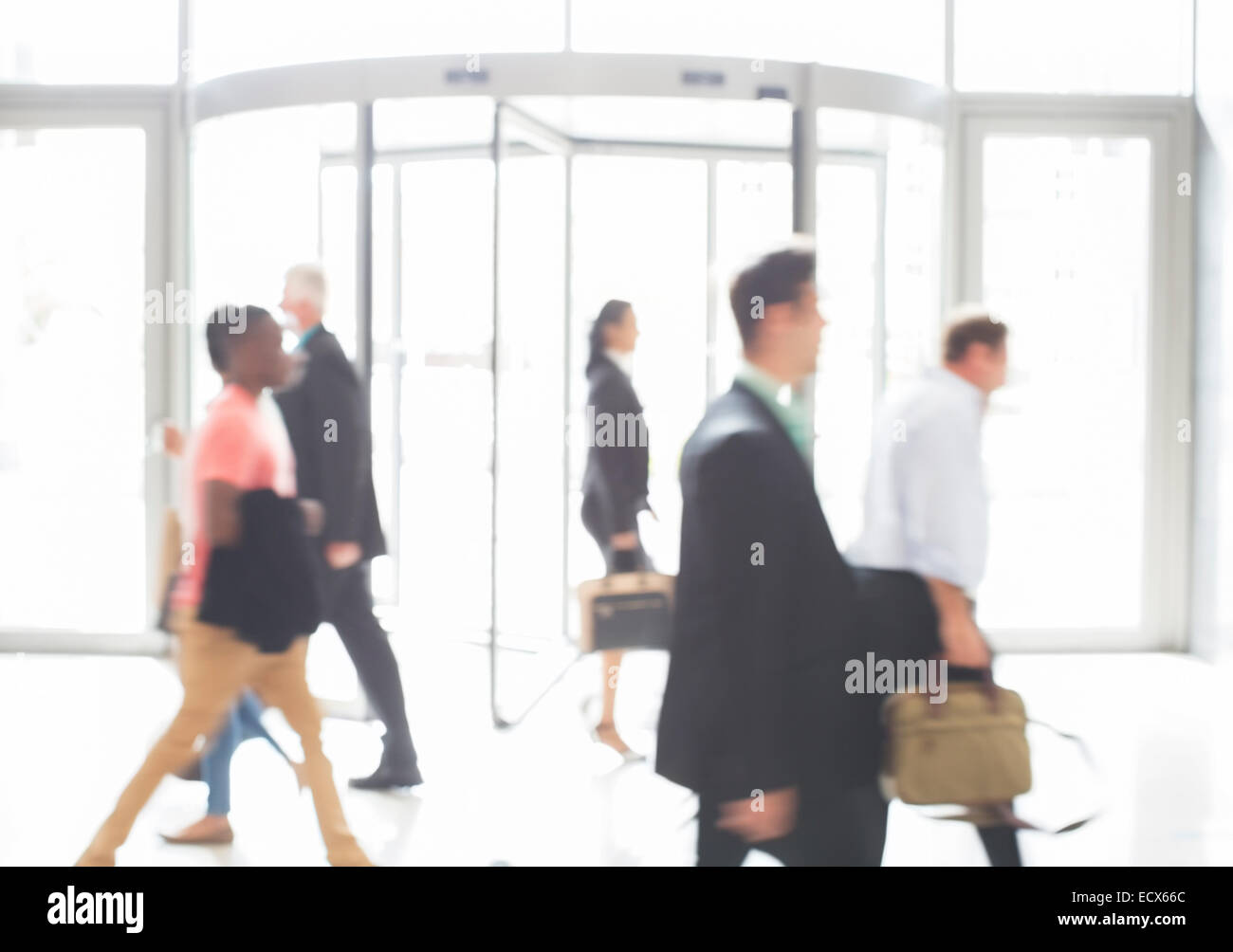 Business people walking in office - Stock Image