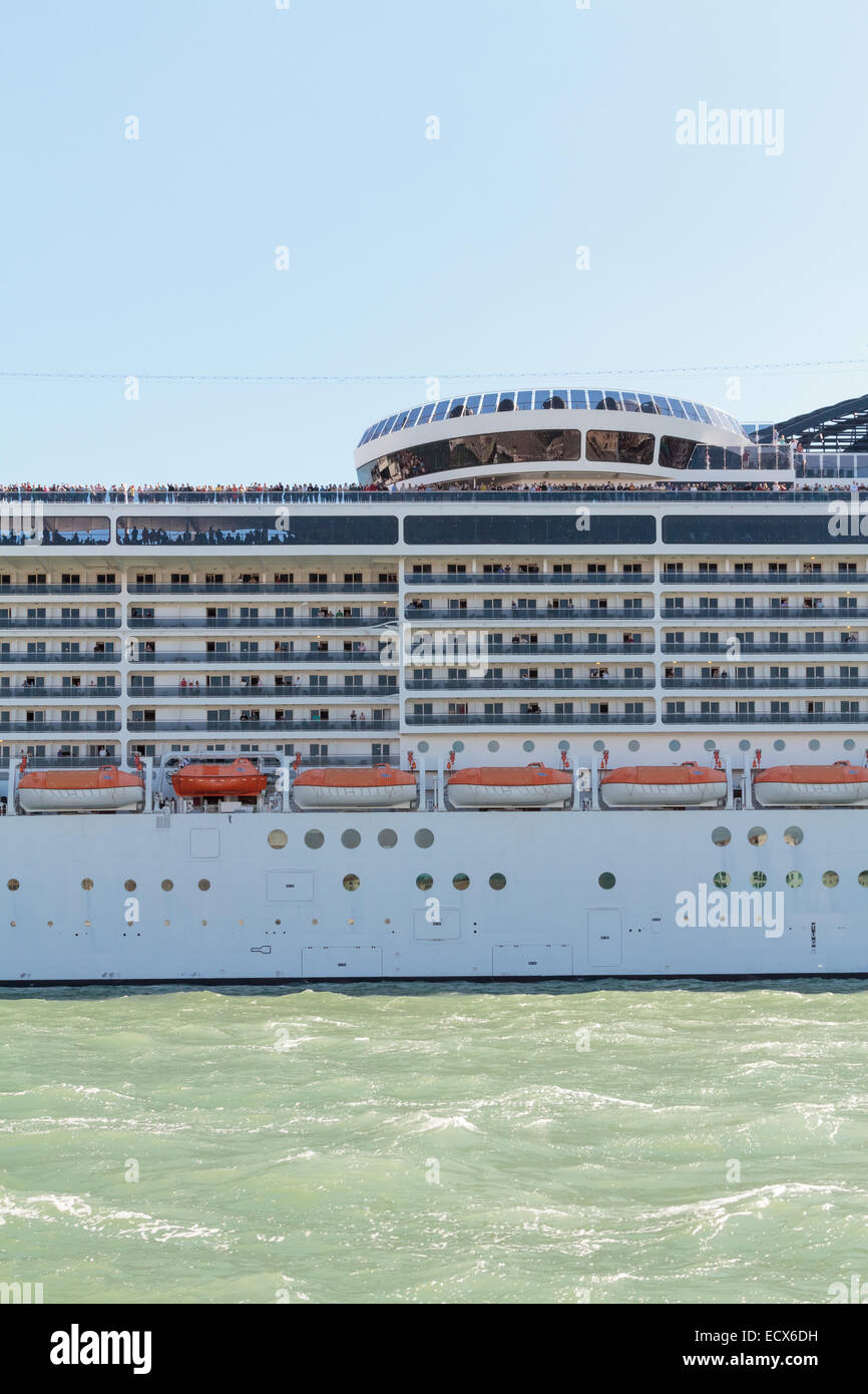 A side of a cruise ship while passing San Marco square of Venice, Italy - Stock Image