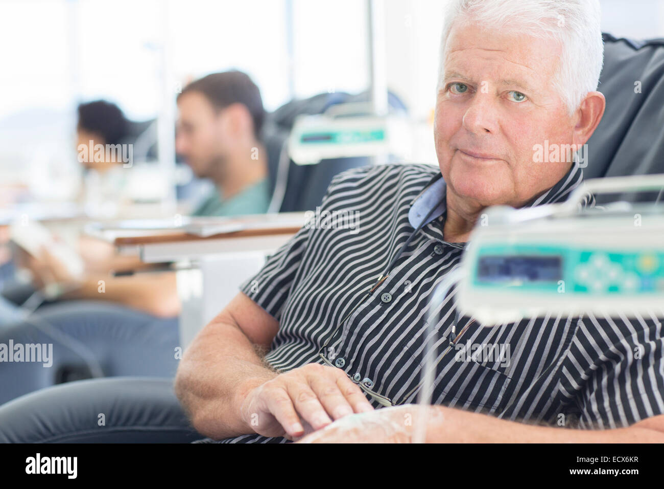 Portrait of patient undergoing medical treatment in outpatient clinic - Stock Image