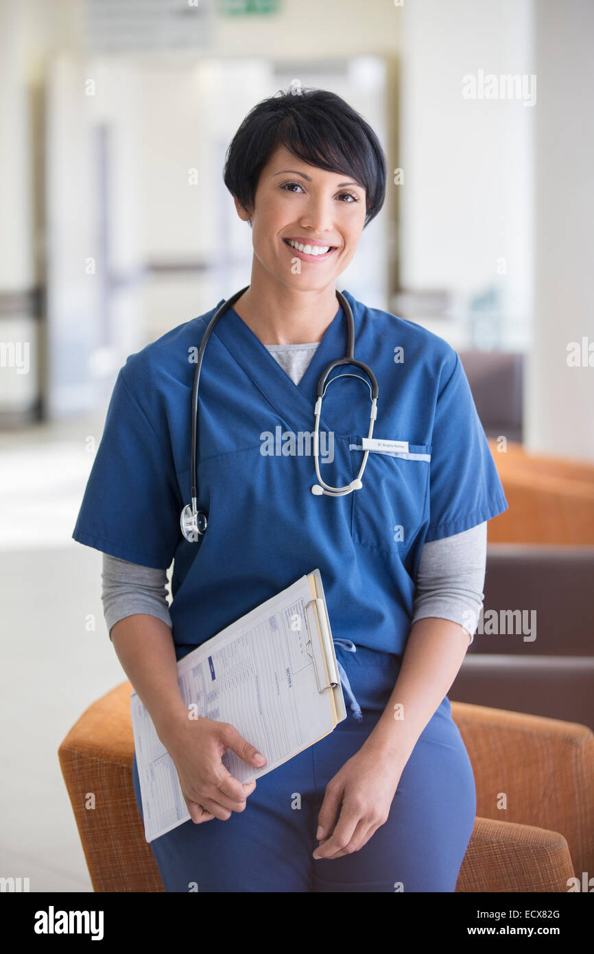 Portrait of female doctor holding clipboard in hospital Stock Photo