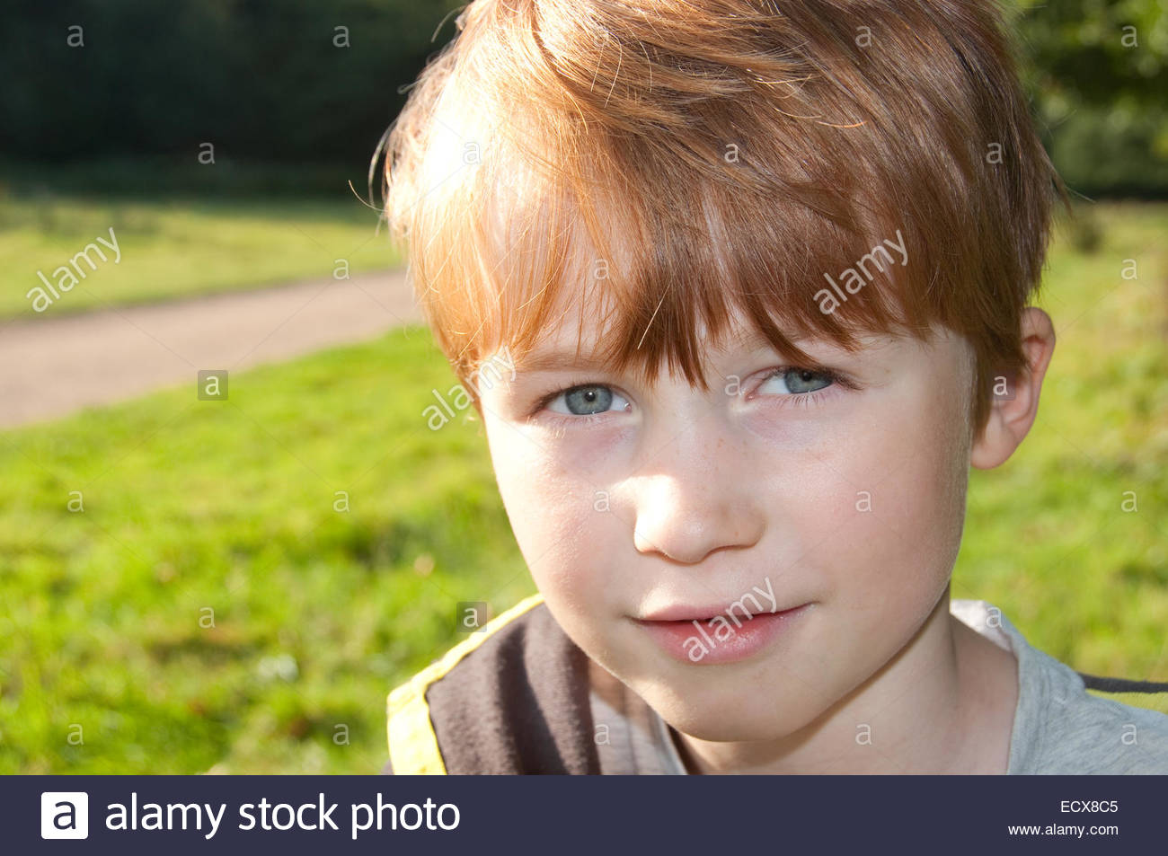 red headed 8 year old boy photographed in norfolk during the summer