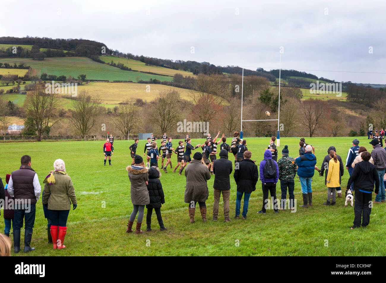 Bathford, Somerset, UK. 21st Dec, 2014. Parents watch Avonvale RFC under 15's play Walcot RFC under 15's on an overcast Stock Photo