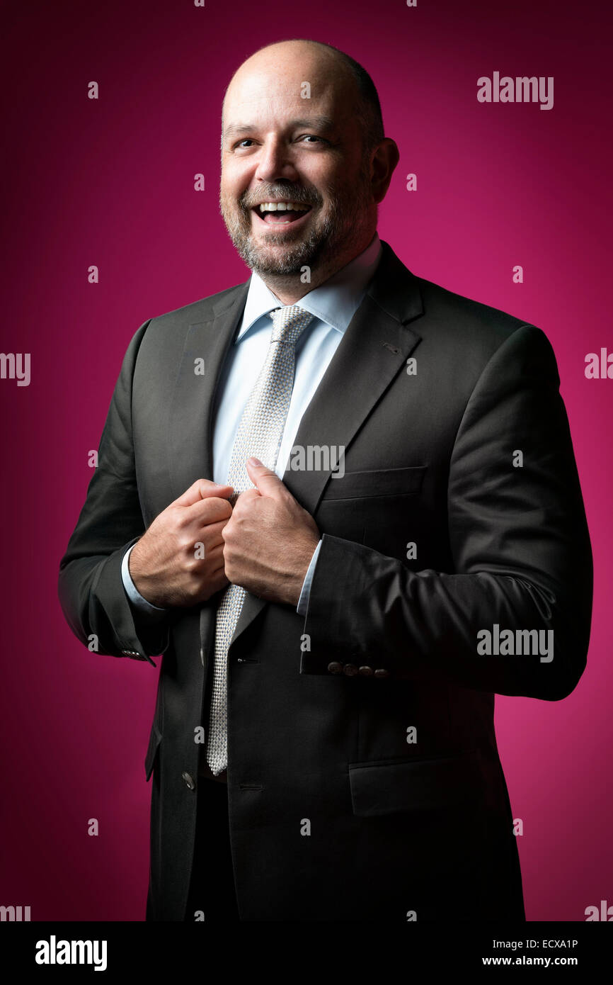 image of a business man with a magenta background Stock Photo