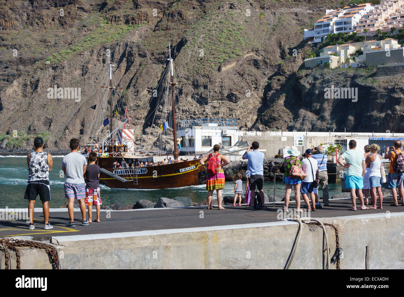 Tenerife - Los Gigantes. Queue waiting to board Flipper Uno dolphin watching boat excursion. - Stock Image