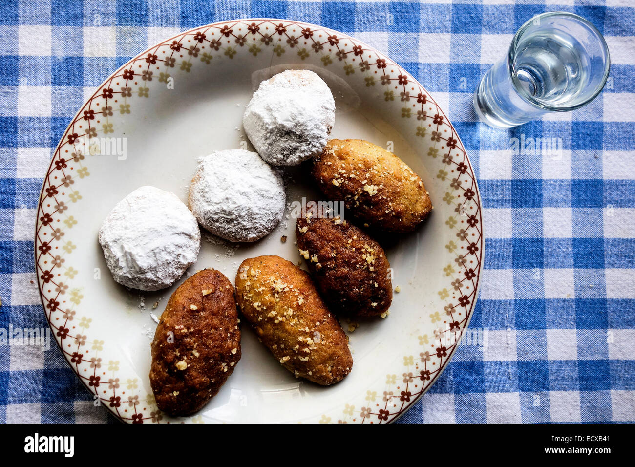 traditional greek christmas bisquits melomakarona kourabiedes and glass of raki tsikoudia stock image - Greek Christmas Food