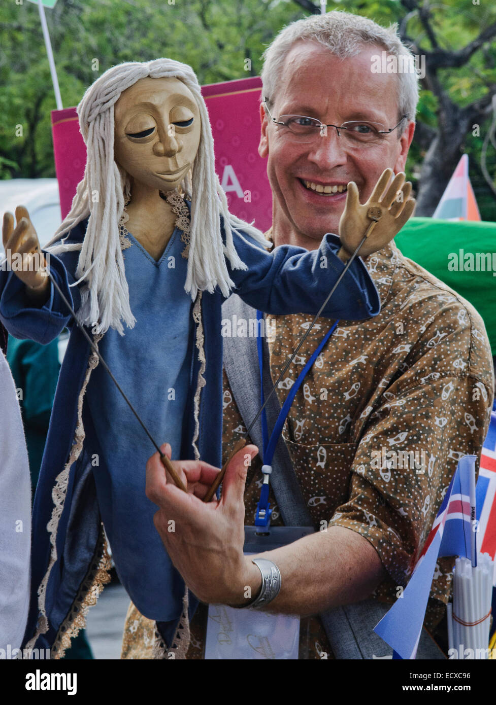 Puppeteer and his puppet at the Harmony World Puppet Festival in Bangkok, Thailand - Stock Image