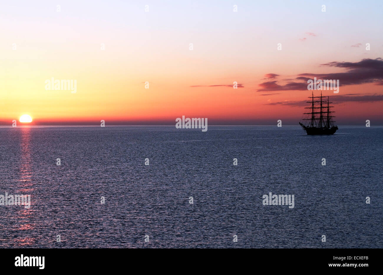 Georg Stage, a three-masted full-rigged Danish training tall ship at sunrise on the Sound in Denmark one spring - Stock Image
